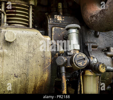 Small tractor manual fuel pump. - Stock Photo