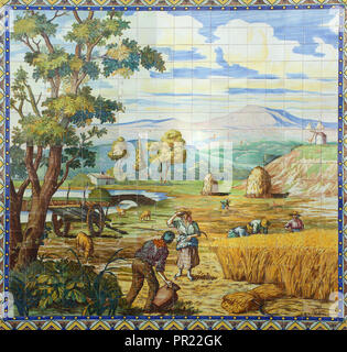 Portugal Typical old Portuguese 'azulejos' - blue and white ceramic tiles depicting rural scene. - Stock Photo