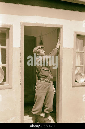 The 'Mazuza' being touched by Yemenite youth when passing through the doorway. 1934 - Stock Photo