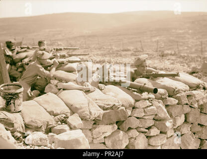 British Military Camp at klm. 41, Lubban-Nablus, Middle East Rd. British troops on observation post with rifles, machine-guns - Stock Photo