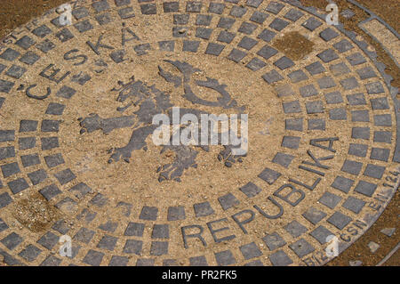 Bohemian heraldic lion depicted on the manhole cover in Prague, Czech Republic. - Stock Photo