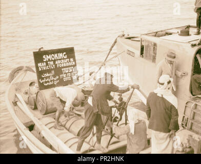 Flying boat 'Satyrus' on Sea of Galilee, ca. 1935. Photograph shows a small boat with sign in English, Arabic and Hebrew reading - Stock Photo