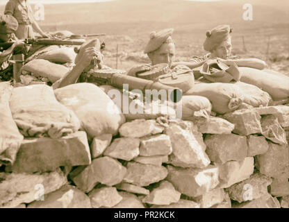 British Military Camp at klm. 41, Lubban-Nablus, Middle East Rd. British troops on observation post with rifles, machine-gunes - Stock Photo