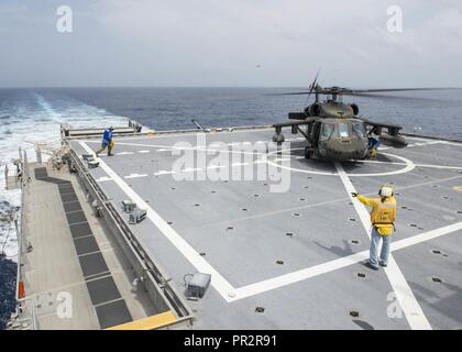 CARIBBEAN SEA (July 26, 2017) Personnel assigned to expeditionary fast transport USNS Spearhead (T-EPF-1) conduct helicopter deck landing qualifications during Southern Partnership Station-Expeditionary Fast Transport 2017. SPS-EPF 17 is a U.S. Navy deployment executed by U.S. Naval Forces Southern Command/U.S. 4th Fleet, focused on subject matter expert exchanges with partner nation militaries and security forces in Central and South America. - Stock Photo