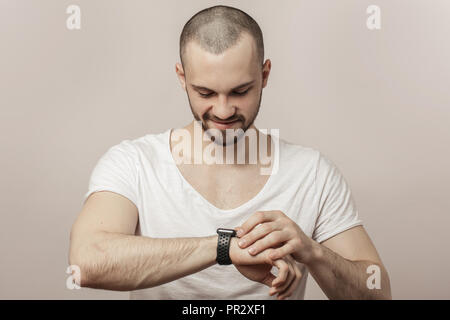 happy, joyful man is looking at the time - Stock Photo