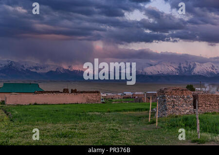 Beautifully located in the Alay Valley between the Zaalay Mountains and the Pamir, Sary Mogol is the starting point for multiple treks. - Stock Photo