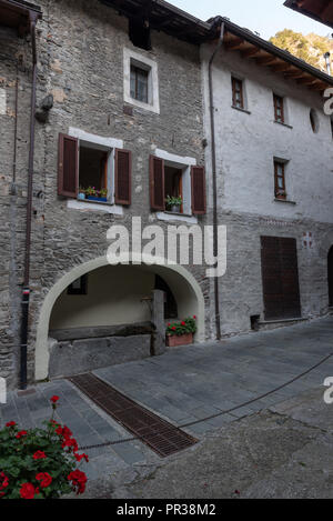 Ancient fountain in the medieval village of Bard in Valle D'Aosta, vertical image - Stock Photo