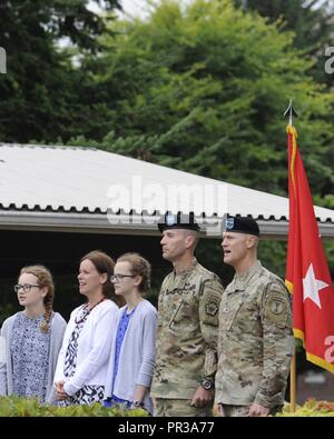 Col. John Becking standing next to his wife Sarah Harger Becking and two daughters Katherine and Rachel at the July 27, 2017 555th Engineer Brigade Change Of Command. Major General Thomas James Jr., 7th Infantry Division Commanding General photographed. - Stock Photo