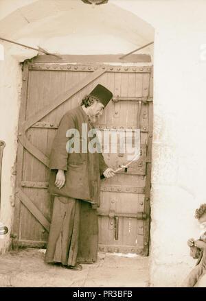 Mar Saba. Doorway with monk closing door 1934, West Bank - Stock Photo