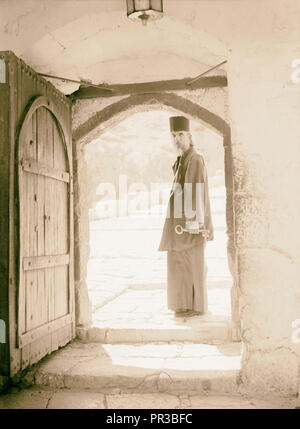 Mar Saba. Doorway with monk looking out 1934, West Bank - Stock Photo