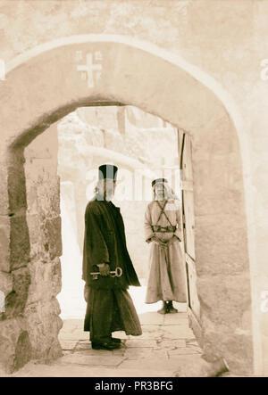 Mar Saba. Doorway with monk looking in. 1934, West Bank - Stock Photo