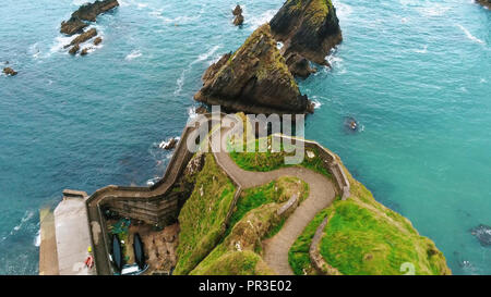 Aerial view over Dunquin Pier on Dingle Peninsula in Ireland - Stock Photo