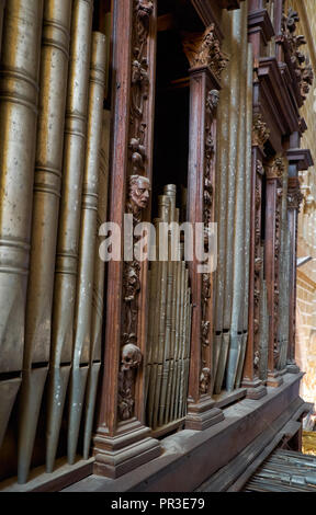 EVORA, PORTUGAL - JULY 01, 2016:  The close view of organ pipes in  baroque case richly decorated with carved work in the Cathedral of Evora. Evora. P - Stock Photo