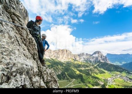 mountain climbers on a Via Ferrata in the Dolomites in Alta Badia - Stock Photo