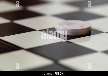 Checkerboard with checkers. Game concept. Board game. Hobby. - Stock Photo