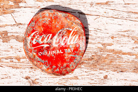 Scratched Coca Cola Bottle Lid, Coca-Cola  was first introduced in 1886 in the USA. - Stock Photo