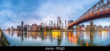 New York, New York, USA skyline of Manhattan from across the East River with Queensboro Bridge at dusk. - Stock Photo