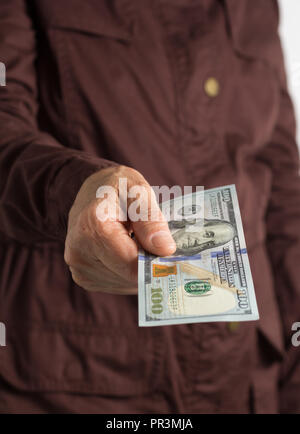 Paper notes from USA. Dollar. North American cash. Front view senior person holding bills. - Stock Photo