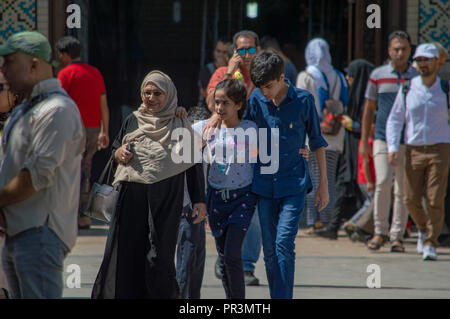 A family walking in Shiraz, Iran - Stock Photo