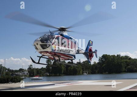 NEENAH, Wis. (July 27, 2017) – Rear Adm. Bruce L. Gillingham, Deputy Chief, Bureau of Medicine and Surgery, Readiness & Health, takes off for a flight in ThedaStar's 2008 Airbus EC 135P2+ light twin-engine helicopter during a tour of the ThedaCare Regional Medical Center as part of Green Bay/Fox Cities Navy Week. Navy Week programs serve as the U.S. Navy's principal outreach effort into areas of the country that lack a significant Navy presence, helping Americans understand that their Navy is deployed around the world, around the clock, ready to defend America at all times. - Stock Photo