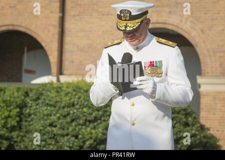 U.S. Navy Rear Adm. Brent W. Scott, 19th chaplain of the Marine Corps, recites an invocation during the retirement ceremony of U.S. Marine Corps Lt. Gen. Ronald L. Bailey, deputy commandant of Plans, Policies and Operations, Marine Barracks Washington, Washington, D.C., July 31, 2017. Bailey retired after 40 years of service in the U.S. Marine Corps. - Stock Photo