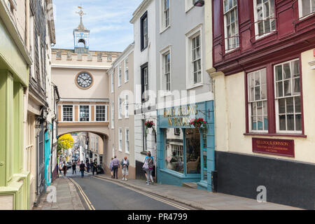 25 May 2018: Totnes, Devon, UK - Shoppers and tourists in the High Street. - Stock Photo