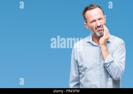 Middle age hoary senior business man over isolated background touching mouth with hand with painful expression because of toothache or dental illness