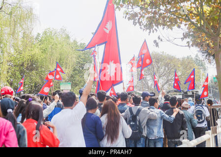 kathmandu,Nepal - Mar 10,2018: People at rally with Nepalese flags in Kathmandu.Protesters - Stock Photo