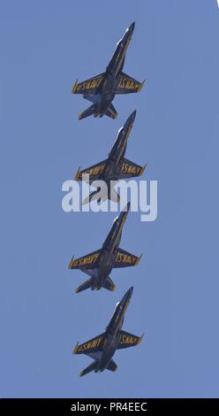 PENSACOLA, Florida. (Sept. 12, 2018) The U.S. Navy Flight Demonstration Squadron, the Blue Angels, Diamond pilots perform the Vertical Break during a practice demonstration at Naval Air Station (NAS) Pensacola. The Blue Angels are scheduled to perform more than 60 demonstrations at more than 30 locations across the U.S. and Canada in 2018. - Stock Photo