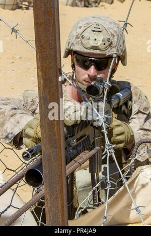 U.S. Marine Corps Lance Cpl. Jordan Hyde, an infantryman assigned to the Fleet Anti-Terrorism Security Team Company, U.S. Central Command, pulls security during a training mission at Mohamed Naguib Military Base, near Alexandria, Egypt, Sept. 13, 2018.  The Marines are participating in Exercise Bright Star 2018, a multilateral U.S. Central Command training exercise, held with the Arab Republic of Egypt. - Stock Photo