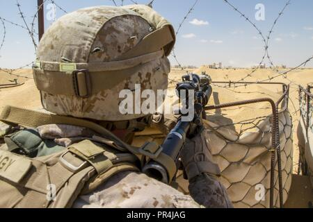 U.S. Marine Corps Lance Cpl. Jordan Silagy, an infantryman assigned to the Fleet Anti-Terrorism Security Team Company, U.S. Central Command, pulls security during a training mission at Mohamed Naguib Military Base, near Alexandria, Egypt, Sept. 13, 2018.  The Marines are participating in Exercise Bright Star 2018, a multilateral U.S. Central Command training exercise, held with the Arab Republic of Egypt. - Stock Photo