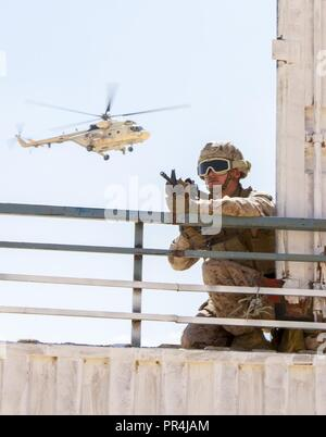 U.S. Marine Corps Lance Cpl. Dakota Bryant, an infantryman assigned to the Fleet Anti-Terrorism Security Team Company, U.S. Central Command, pulls security during a training mission at Mohamed Naguib Military Base, near Alexandria, Egypt, Sept. 13, 2018.  The Marines are participating in Exercise Bright Star 2018, a multilateral U.S. Central Command training exercise, held with the Arab Republic of Egypt. - Stock Photo