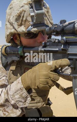 U.S. Marine Corps Lance Cpl. Justin Lopez, an infantryman assigned to the Fleet Anti-Terrorism Security Team Company, U.S. Central Command, pulls security during a training mission at Mohamed Naguib Military Base, near Alexandria, Egypt, Sept. 13, 2018.  The Marines are participating in Exercise Bright Star 2018, a multilateral U.S. Central Command training exercise, held with the Arab Republic of Egypt. - Stock Photo