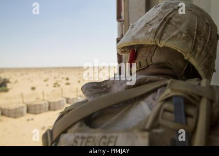 U.S. Marine Corps Lance Cpl. Albert Stengel, an infantryman assigned to the Fleet Anti-Terrorism Security Team Company, U.S. Central Command, pulls security during a training mission at Mohamed Naguib Military Base, near Alexandria, Egypt, Sept. 13, 2018.  The Marines are participating in Exercise Bright Star 2018, a multilateral U.S. Central Command training exercise, held with the Arab Republic of Egypt. - Stock Photo