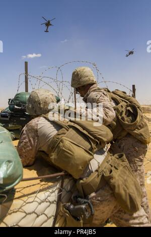 From left, U.S. Marine Corps Pfc. Cody Smith and Lance Cpl. Anthony Spencer, both infantrymen assigned to the Fleet Anti-Terrorism Security Team Company, U.S. Central Command, pull security during a training mission at Mohamed Naguib Military Base, near Alexandria, Egypt, Sept. 13, 2018.  The Marines are participating in Exercise Bright Star 2018, a multilateral U.S. Central Command training exercise, held with the Arab Republic of Egypt. - Stock Photo