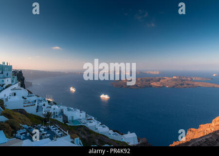 View over Imerovigli and Skaros in Santorini in Greece - Stock Photo
