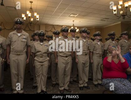 Fla. (Sept. 14, 2018) Newly frocked chief petty officers, assigned to the Wasp-class amphibious assault ship USS Iwo Jima (LHD 7), stand in formation after receiving their chief anchors during the ship's fiscal year 2019 chief petty officer pinning ceremony at the Ocean Breeze Conference Center onboard Naval Station Mayport. During the ceremony, 19 Iwo Jima Sailors received their chief anchors and covers as they were promoted to the rank of chief petty officer. - Stock Photo