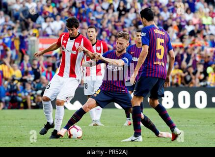 Barcelona, Spain. 29th Sep, 2018. FC Barcelona's Ivan Rakitic (C) duels for the ball with Athletic Club's Mikel San Jose (L) during their Spanish Liga Primera Division soccer match played at Camp Nou stadium in Barcelona, Spain, 29 September 2018. Credit: Marta Perez/EFE/Alamy Live News - Stock Photo