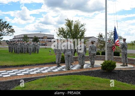Airmen with the 181st Intelligence Wing stand in formation during a retreat ceremony at Hulman Field Air National Guard Base, Terre Haute, Indiana, Sep. 16, 2018. - Stock Photo