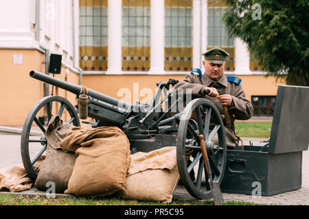Gomel, Belarus - November 7, 2017: White Guard artilleryman prepares a weapon for battle with the Red Army. Reconstruction of the Socialist October Re - Stock Photo