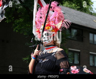 London, UK - August 27, 2018:  Notting Hill Carnival Woman with sugar skull makeup - Stock Photo