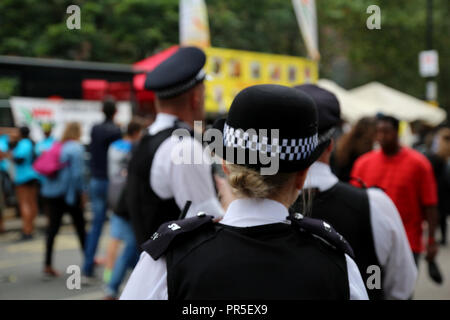UK Police officers on duty on a city center street during special event - Stock Photo