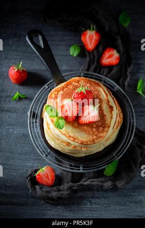 Homemade american pancakes with fresh strawberries and sugar - Stock Photo