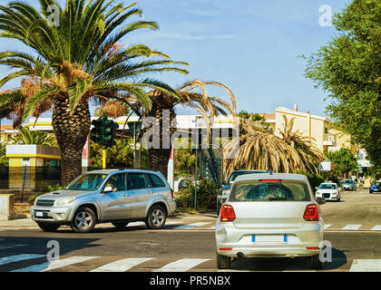 Cars on road in Santa Teresa Gallura, Sardinia, Italy - Stock Photo