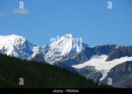 A panoramic view of the beautiful snow capped mountains, glaciers and forest of Wrangell- St. Elias National Park in Alaska, USA - Stock Photo