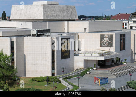 Serbian national theatre building entrance in Novi Sad during sunny day with posters promoting repertoire of current plays that can be seen. - Stock Photo