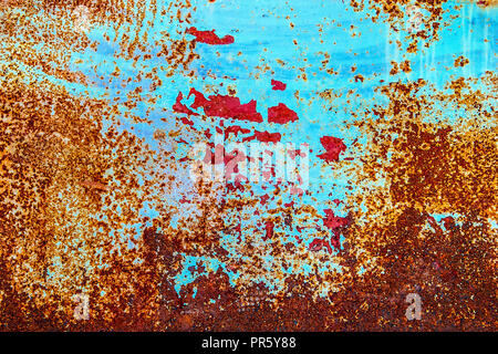 Closeup of rusted metal surface with peeling paint. - Stock Photo