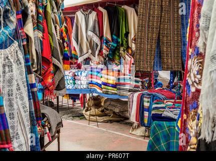 Saturday Handicraft Market, Plaza de los Ponchos, Otavalo, Imbabura Province, Ecuador - Stock Photo