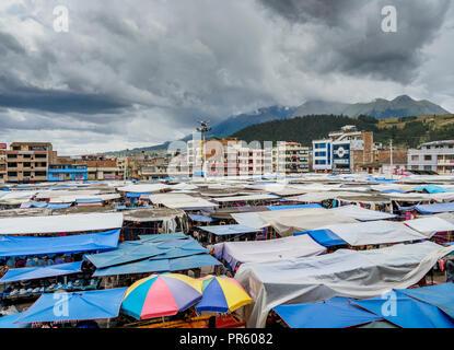 Saturday Handicraft Market, Plaza de los Ponchos, elevated view, Otavalo, Imbabura Province, Ecuador - Stock Photo