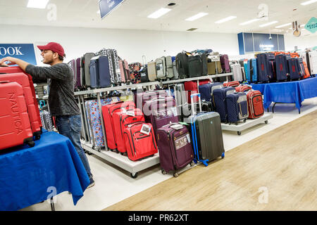 Miami Florida Kendall The Palms at Town & Country Mall Marshalls discount department store inside shopping display sale luggage suitcases man looking - Stock Photo